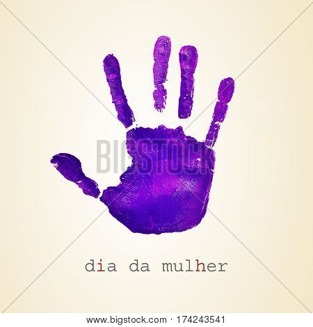 a violet handprint and the text dia da mulher, womens day in portuguese, on a beige background