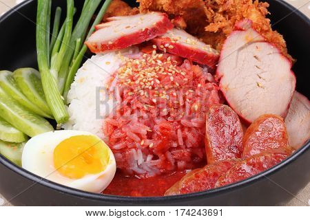 Jasmine Rice With Meat And Boiled Egg Topped Red Sweet Sauce .