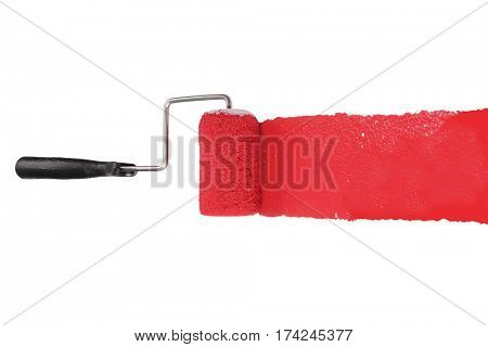Paint roller with red pigment isolated over white background