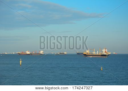 Seascape With Many Cargo Ships In Singapore