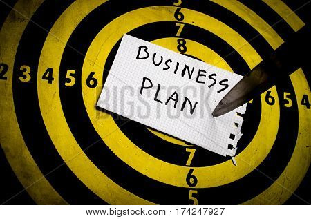 Cogent business plan ,knife on target dart board to goal, business concept to goal copy space background