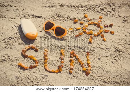 Vintage Photo, Word And Shape Of Sun, Sunglasses With Sun Lotion On Sand At Beach, Summer Time