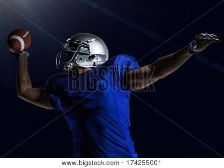 Digital composition of american football player throwing rugby ball against blue background