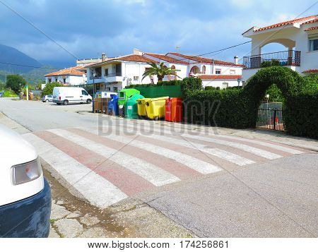 Bermejo Spain - February 24 2017: Colorful collection of rubbish bins in village street
