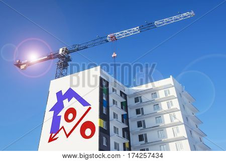 Billboard on the background of building a house . The concept of reducing property prices