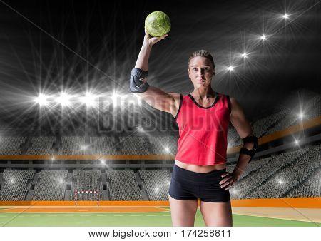 Digital composition of female handball player holding ball at handball court