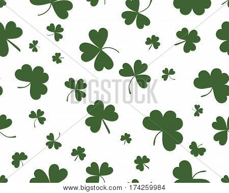 St Patrick's Day background with three leaves clover. Green on white color. The Symbol Of Ireland. The Irish pattern.  St Patrick's Day background with three leaves clover. Green on white color. The Symbol Of Ireland. The Irish pattern. Vector seamless ba