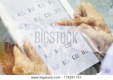 student testing quiz online in exercise exams answer on a tablet with multiple-choice questions by finger clicking exam student background and education concept double exposure tone