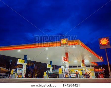Kedah, Malaysia - February 27, 2017: Shell gas station blue sky background during sunset. Royal Dutch Shell sold its Australian Shell retail operations to Dutch company Vitol in 2014