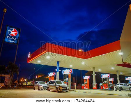 Kedah, Malaysia - February 27, 2017: Caltex gas station blue sky background during sunset. Caltex is a petroleum brand name of Chevron Corporation used in more than 60 countries.