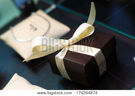 gift box with golden ribbon, glittery gold background gift box bow