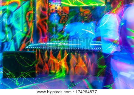 The people having fun in a disco. blur effect for an artistic touch