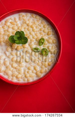 Dahi Bundi or Boondi Raita, favourite indian started or side dish made using Rajasthani snack food made from sweetened, fried chickpea flour, called Boondi with sweet and salty curd or buttermilk