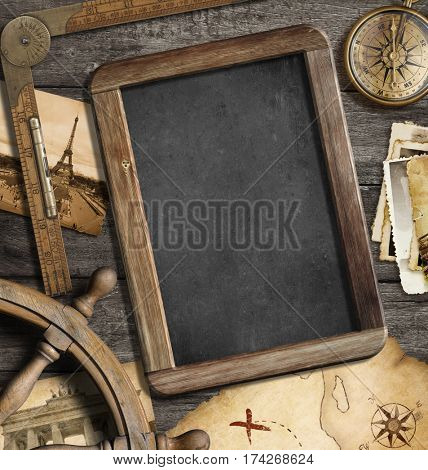 Vintage treasure map, blackboard with copyspace, old compass still life. Adventure or discovery concept. 3D illustration.