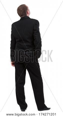 backside view of person. back view of Businessman watching. Young guy in black suit looks ahead.  Rear view people collection.    Isolated over white background