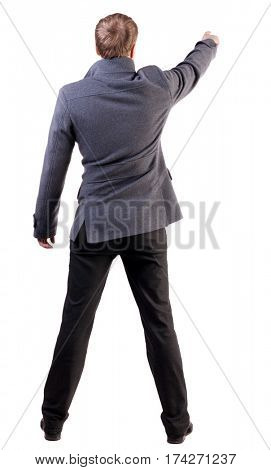 Back view of pointing business man. gesticulating young guy in gray coat. Rear view people collection.  backside view of person.  Isolated over white background.