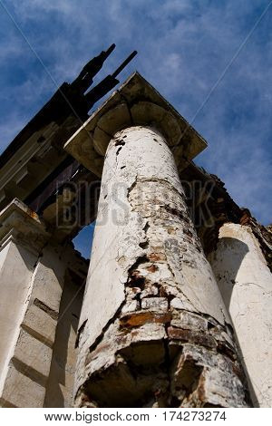 Old collapsing column against the sky. Anastasovsky Parish.