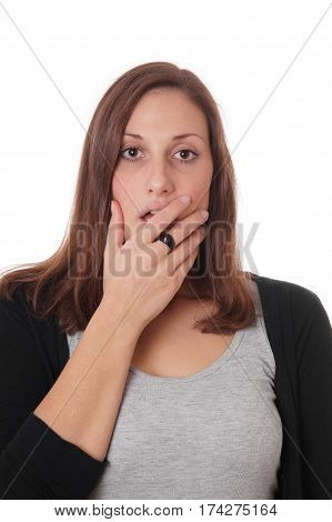 surprised young woman covering her wide open mouth with her hand