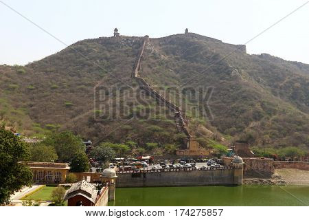 Amber fort is located in the northern suburbs of Jaipur, on the crest of a rocky hill behind the Maota Lake, India poster