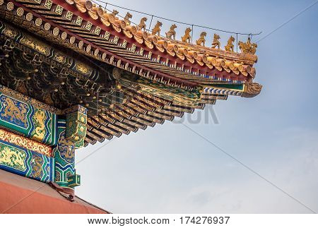 Beijing, China - Oct 30, 2016: Mythical beasts on roof gable of the Hall of Supreme Harmony (Taihedian). Forbidden City (Gu Gong, Palace Museum). Also called roof charms, roof figures or walking beasts.