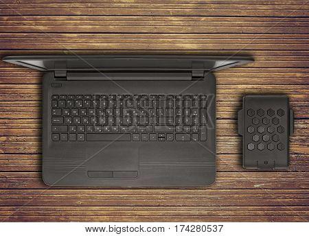 Black Laptop With An External Hard Drive