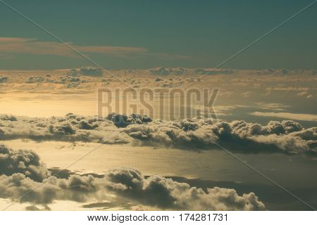 Fluffy White Clouds On Blue Sky Over Idyllic Sea