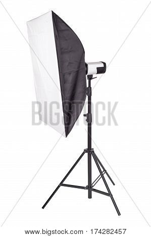 Studio lighting soft box on a tripod stand isolated on a white background.
