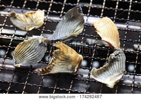 grilling dried blowfish fins for Hirezake (Japanese hot sake drink ).