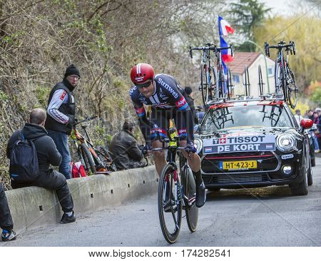 Conflans-Sainte-HonorineFrance-March 62016: Image of the Dutch cyclist Koen de Kort of Giant-Alpecin Team riding during the prologue stage of Paris-Nice 2016.