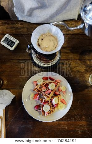Drip Coffee Set Preparing By Barista And Waffle Mix Fruits From Top View