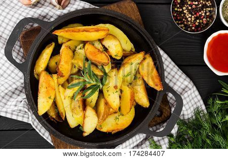 Fried Potatoes With Fresh Rosemary In Cast-iron Pan, Rustic Style.