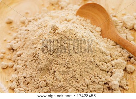 pile of raw germinated brown rice with spoon