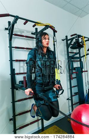 The female athlete doing they exercise in the EMS fitness studio