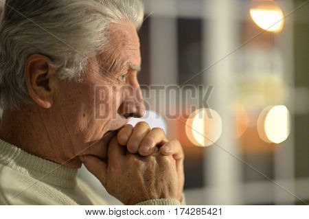 Portrait of a upset mature man close up