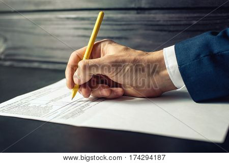 Man Lawyer Or Official Signs Documents With A Pen