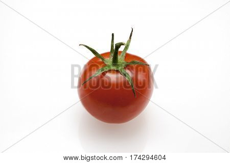 Fresh juicy fruit Sicilian varieties Sungold of tomato closeup on white background