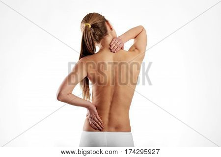 Naked woman torso with painful back. Lumbago problem.
