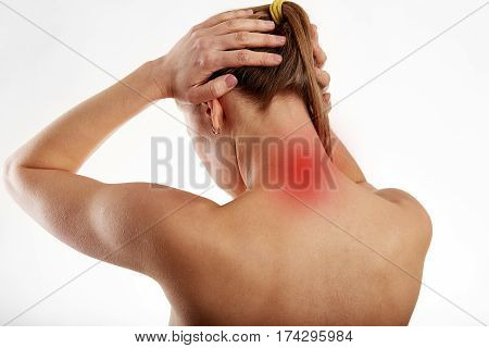 Woman touching her head suffering from neck ache and stress. Health care concept.
