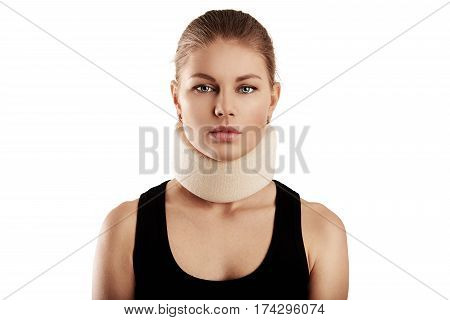 Portrait of young woman wearing neck collar. Concept of cervical sprain and therapy.