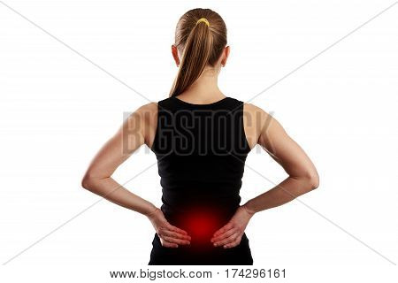 Fitness woman suffering from lumbar pain over white background.