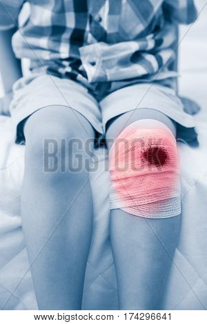 Child Injured. Wound On Child's Knee With Bandage. Human Health Care And Medicine Concept.