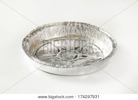 Used round tin foil cake pan on white background