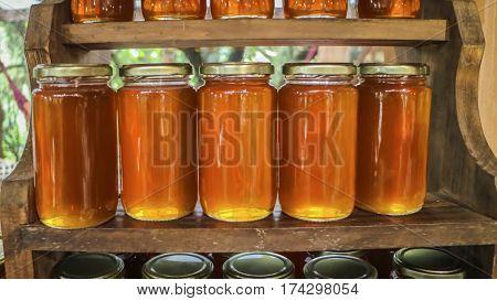 Flowery Yellow Honey In Glass Jar