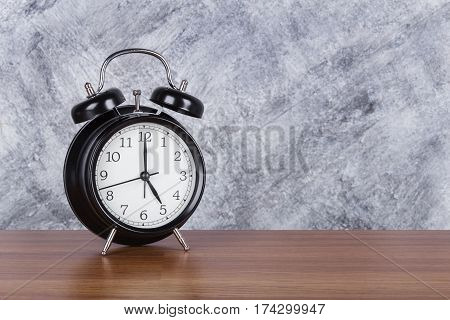 5 O'clock Vintage Clock On Wood Table And Wall Background