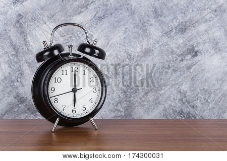 6 O'clock Vintage Clock On Wood Table And Wall Background