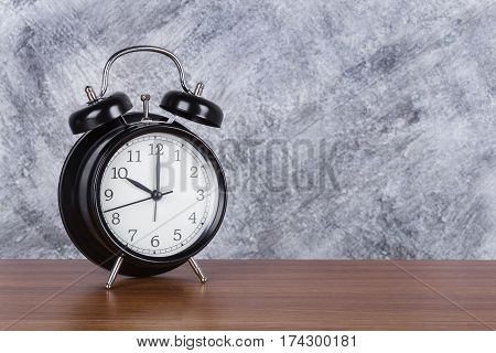 10 O'clock Vintage Clock On Wood Table And Wall Background