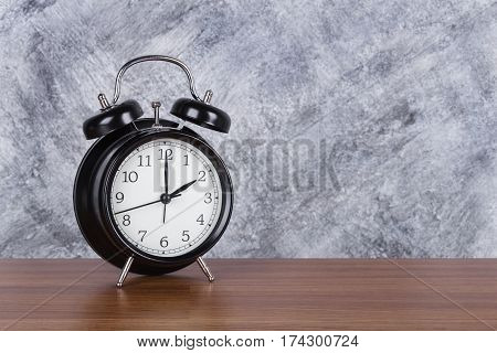 2 O'clock Vintage Clock On Wood Table And Wall Background