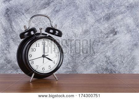 4 O'clock Vintage Clock On Wood Table And Wall Background