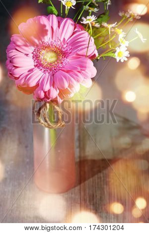 Spring flowers in a glass vase for mothers day with tender bokeh in country house style