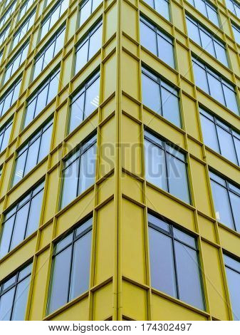 Office building. Yellow and blue architectural detail. Close-up